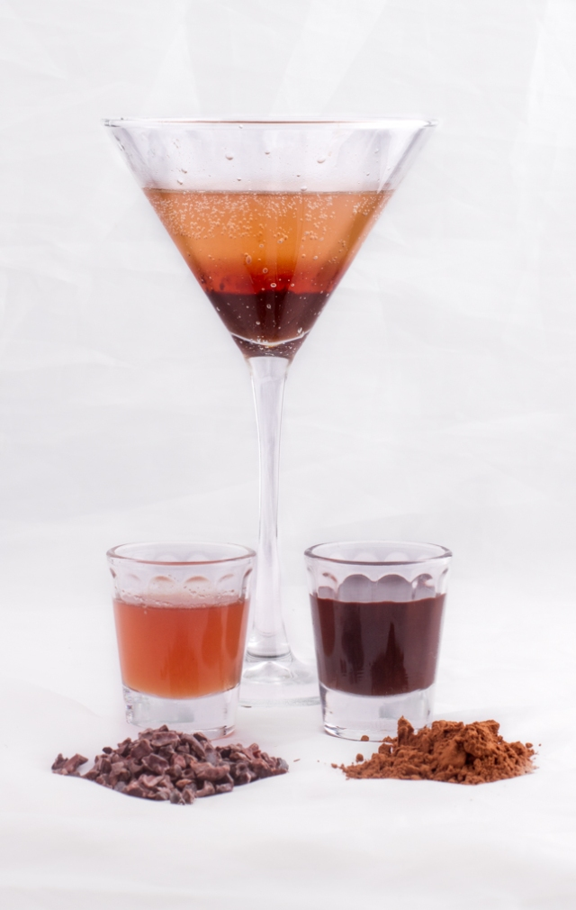 The difference between Cacao and Cocoa. From left to right: Cacao Nibs, Cacao Nib Syrup, Chocolate Mocktini, Chocolate Syrup and Cocoa Powder.